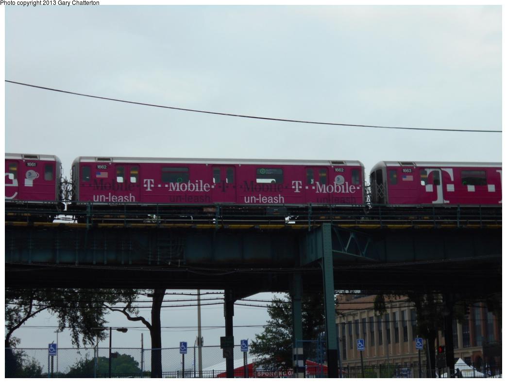 (270k, 1044x788)<br><b>Country:</b> United States<br><b>City:</b> New York<br><b>System:</b> New York City Transit<br><b>Line:</b> IRT Flushing Line<br><b>Location:</b> Willets Point/Mets (fmr. Shea Stadium) <br><b>Route:</b> 7<br><b>Car:</b> R-62A (Bombardier, 1984-1987)  1664 <br><b>Photo by:</b> Gary Chatterton<br><b>Date:</b> 7/13/2013<br><b>Notes:</b> T-Mobile wrap<br><b>Viewed (this week/total):</b> 1 / 877