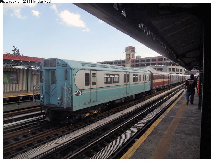 (202k, 820x620)<br><b>Country:</b> United States<br><b>City:</b> New York<br><b>System:</b> New York City Transit<br><b>Line:</b> BMT Astoria Line<br><b>Location:</b> 39th/Beebe Aves. <br><b>Route:</b> Museum Train Service<br><b>Car:</b> R-33 World's Fair (St. Louis, 1963-64) 9306 <br><b>Photo by:</b> Nicholas Noel<br><b>Date:</b> 7/14/2013<br><b>Notes:</b> Yard move from Flushing Line<br><b>Viewed (this week/total):</b> 1 / 987