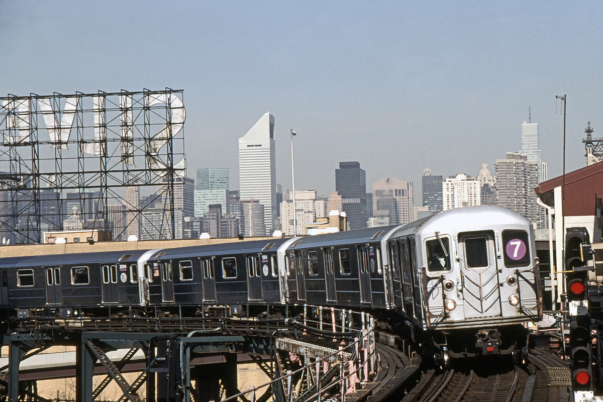(394k, 1044x721)<br><b>Country:</b> United States<br><b>City:</b> New York<br><b>System:</b> New York City Transit<br><b>Line:</b> IRT Flushing Line<br><b>Location:</b> Queensborough Plaza <br><b>Route:</b> 7<br><b>Car:</b> R-62A (Bombardier, 1984-1987)  2015-1984-2020-etc <br><b>Photo by:</b> David Warner<br><b>Collection of:</b> David Pirmann<br><b>Date:</b> 4/18/2008<br><b>Viewed (this week/total):</b> 1 / 982