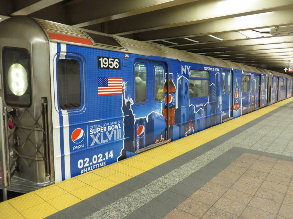 (144k, 1024x768)<br><b>Country:</b> United States<br><b>City:</b> New York<br><b>System:</b> New York City Transit<br><b>Line:</b> IRT Times Square-Grand Central Shuttle<br><b>Location:</b> Grand Central <br><b>Route:</b> S<br><b>Car:</b> R-62A (Bombardier, 1984-1987)  1956 <br><b>Photo by:</b> Robbie Rosenfeld<br><b>Date:</b> 1/19/2014<br><b>Notes:</b> Pepsi wrap<br><b>Viewed (this week/total):</b> 0 / 769