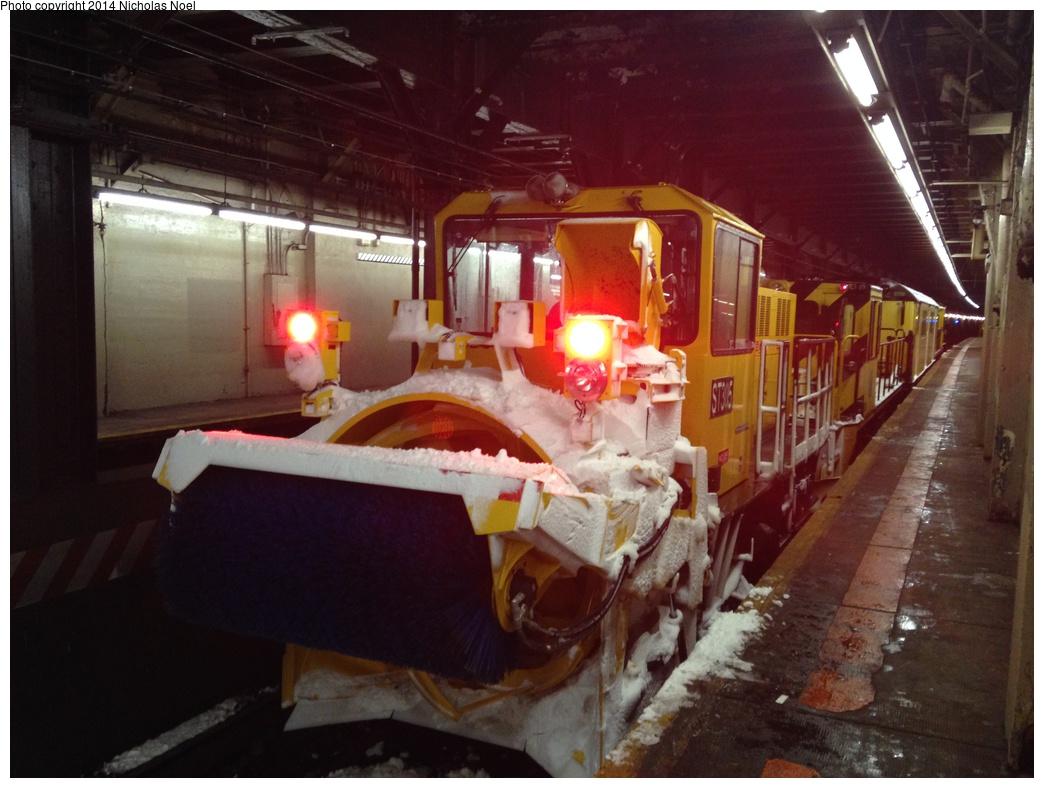 (269k, 1044x788)<br><b>Country:</b> United States<br><b>City:</b> New York<br><b>System:</b> New York City Transit<br><b>Line:</b> IRT Dyre Ave. Line<br><b>Location:</b> Pelham Parkway <br><b>Route:</b> Work Service<br><b>Car:</b> R-146 Snow Removal Car ST305 <br><b>Photo by:</b> Nicholas Noel<br><b>Date:</b> 2/13/2014<br><b>Viewed (this week/total):</b> 5 / 1505