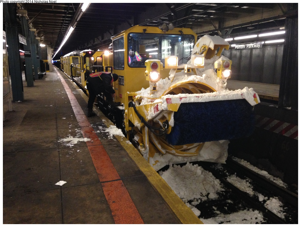 (303k, 1044x788)<br><b>Country:</b> United States<br><b>City:</b> New York<br><b>System:</b> New York City Transit<br><b>Line:</b> IRT Dyre Ave. Line<br><b>Location:</b> Pelham Parkway <br><b>Route:</b> Work Service<br><b>Car:</b> R-146 Snow Removal Car ST303 <br><b>Photo by:</b> Nicholas Noel<br><b>Date:</b> 2/13/2014<br><b>Viewed (this week/total):</b> 4 / 1510