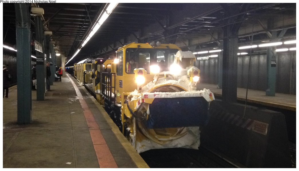 (208k, 1044x596)<br><b>Country:</b> United States<br><b>City:</b> New York<br><b>System:</b> New York City Transit<br><b>Line:</b> IRT Dyre Ave. Line<br><b>Location:</b> Pelham Parkway <br><b>Route:</b> Work Service<br><b>Car:</b> R-146 Snow Removal Car ST303 <br><b>Photo by:</b> Nicholas Noel<br><b>Date:</b> 2/13/2014<br><b>Viewed (this week/total):</b> 0 / 1490