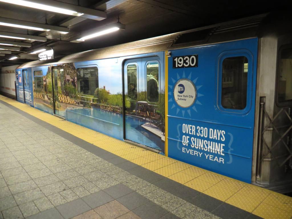 (118k, 1024x768)<br><b>Country:</b> United States<br><b>City:</b> New York<br><b>System:</b> New York City Transit<br><b>Line:</b> IRT Times Square-Grand Central Shuttle<br><b>Location:</b> Grand Central <br><b>Route:</b> S<br><b>Car:</b> R-62A (Bombardier, 1984-1987)  1930 <br><b>Photo by:</b> Robbie Rosenfeld<br><b>Date:</b> 2/12/2014<br><b>Notes:</b> Scottsdale AZ wrap<br><b>Viewed (this week/total):</b> 0 / 916