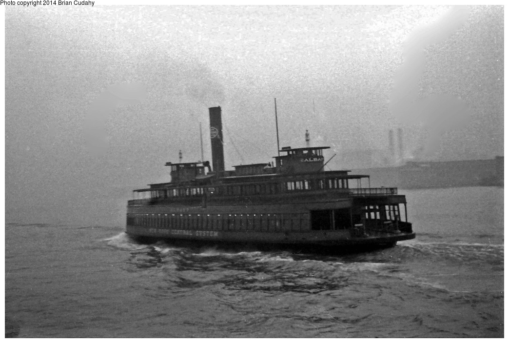 (258k, 1044x703)<br><b>Country:</b> United States<br><b>System:</b> New York Central <br><b>Photo by:</b> Brian J. Cudahy<br><b>Notes:</b> New York Central Railroad's ferryboat Albany crosses the Hudson on another trip from Manhattan to Weehawken.<br><b>Viewed (this week/total):</b> 5 / 1734