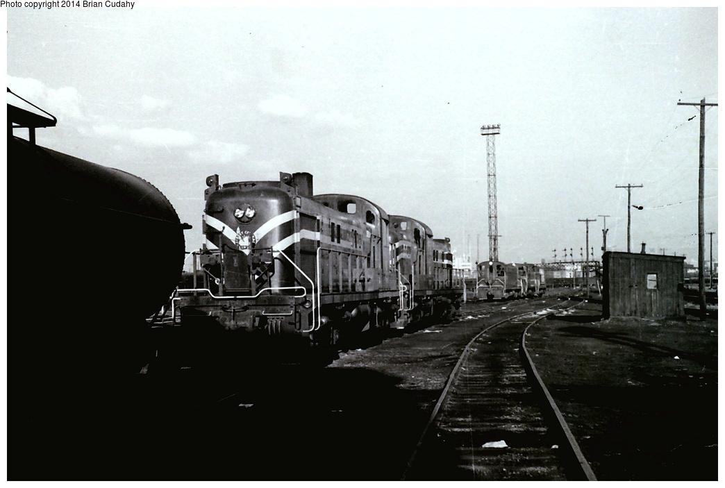 (203k, 1044x703)<br><b>Country:</b> United States<br><b>System:</b> CRRNJ <br><b>Photo by:</b> Brian J. Cudahy<br><b>Notes:</b> RS-3 units at CNJ's Communipaw engine terminal ... November 1, 1954   <br><b>Viewed (this week/total):</b> 2 / 1748