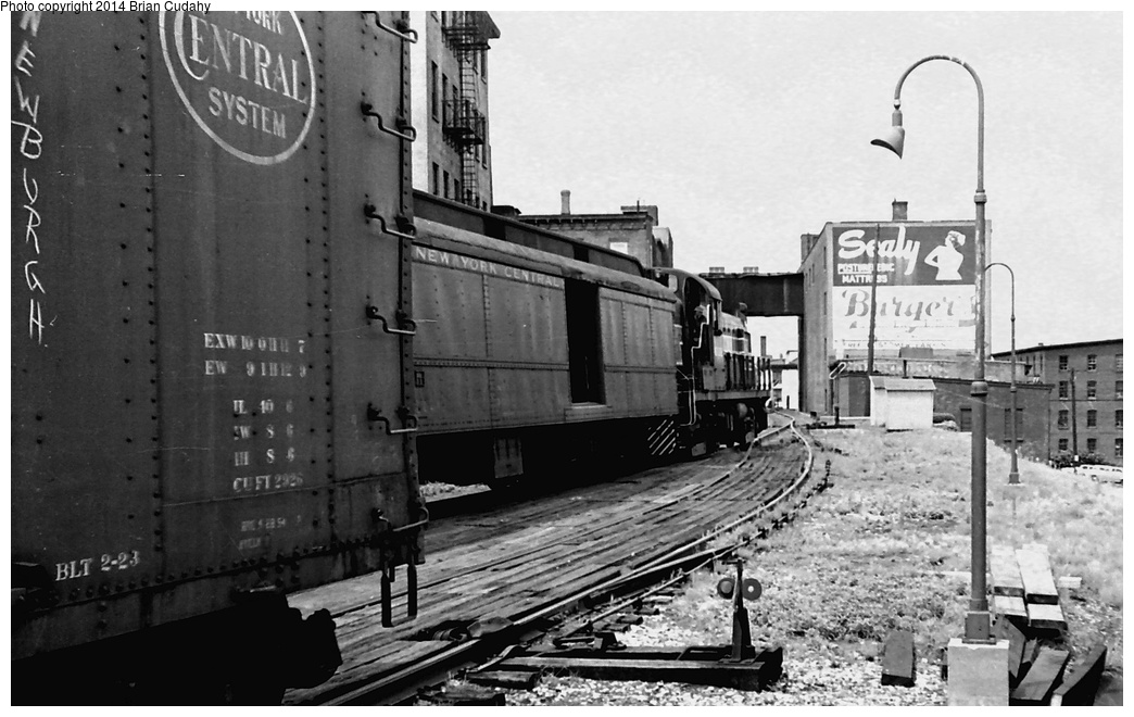 (262k, 1044x660)<br><b>Country:</b> United States<br><b>System:</b> New York Central <br><b>Photo by:</b> Brian J. Cudahy<br><b>Notes:</b> Summer 1955. Two trains operating between Weehawken and Albany meet at Newburg, NY. Both are powered by Alco-GE RS-3 units.<br><b>Viewed (this week/total):</b> 4 / 1893