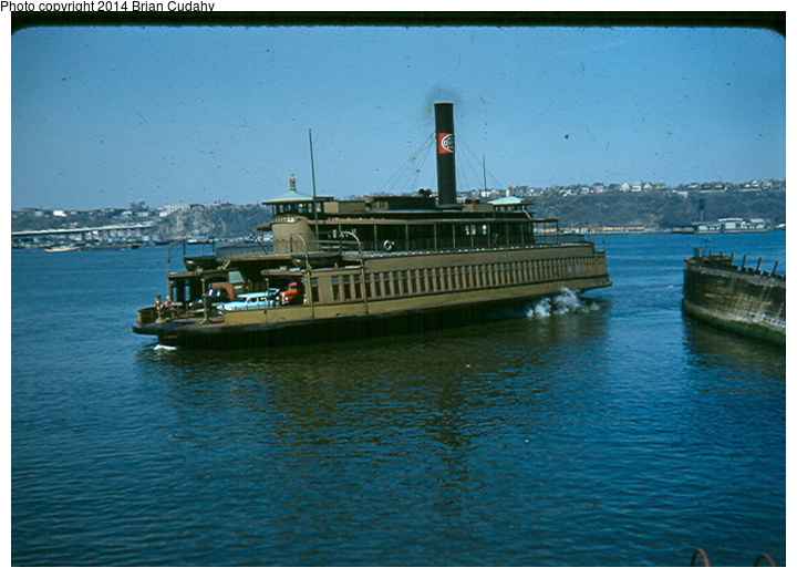 (161k, 720x522)<br><b>Country:</b> United States<br><b>System:</b> New York Central <br><b>Photo by:</b> Brian J. Cudahy<br><b>Notes:</b> New York Central ferryboat Rochester approaches slip at the foot of Manhattan's West 42d Street; summer 1954.<br><b>Viewed (this week/total):</b> 5 / 1983