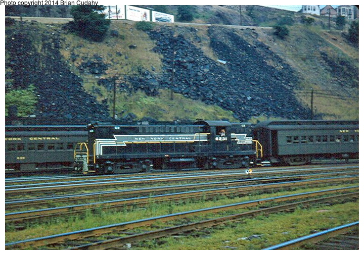 (219k, 720x505)<br><b>Country:</b> United States<br><b>System:</b> New York Central <br><b>Photo by:</b> Brian J. Cudahy<br><b>Notes:</b> NYC Lima-Hamilton road switcher No. 6231 brings a West Shore train into Weehawken; summer 1954.<br><b>Viewed (this week/total):</b> 2 / 2153