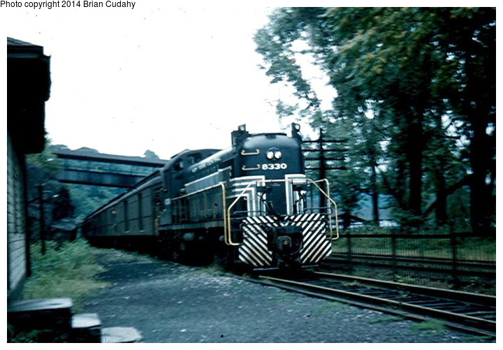 (146k, 720x501)<br><b>Country:</b> United States<br><b>System:</b> New York Central <br><b>Photo by:</b> Brian J. Cudahy<br><b>Notes:</b> An Albany-to-Weehawken train on the West Shore Division pauses to pick up passengers at Bear Mountain. August 30, 1954. <br><b>Viewed (this week/total):</b> 6 / 1700