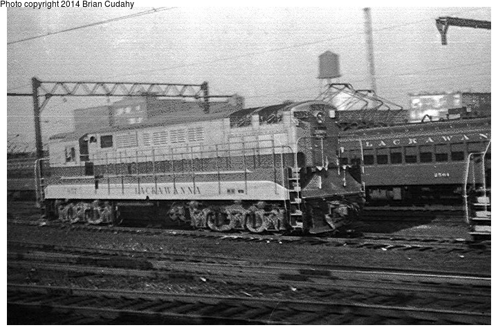 (172k, 720x481)<br><b>Country:</b> United States<br><b>System:</b> DL&W <br><b>Photo by:</b> Brian J. Cudahy<br><b>Notes:</b> DL&W Trainmaster diesel outside Hoboken Terminal ... 1955.<br><b>Viewed (this week/total):</b> 3 / 1785