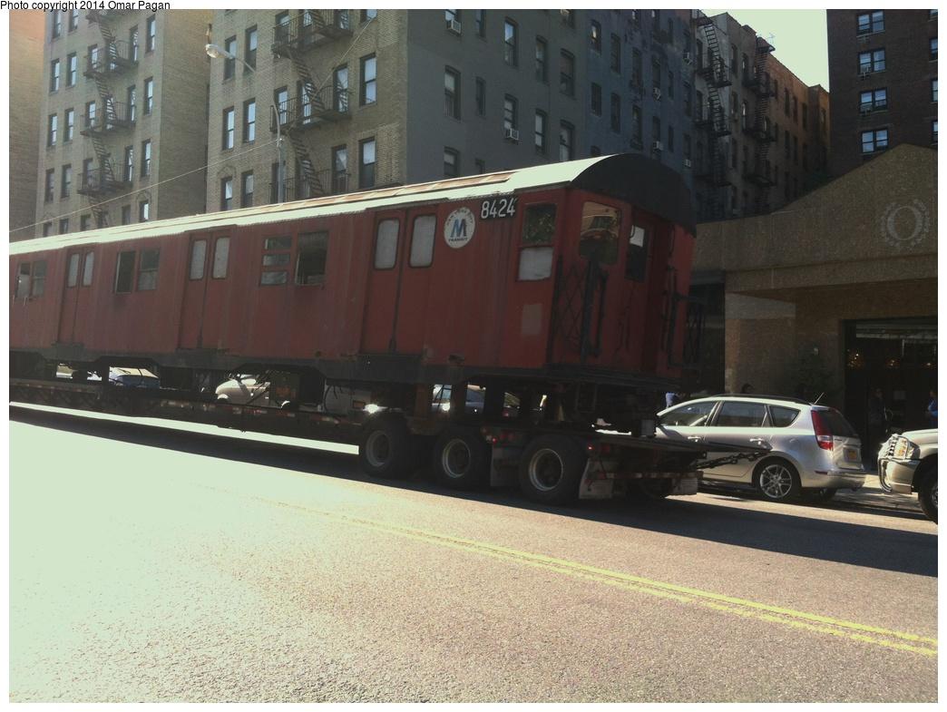 (302k, 1044x785)<br><b>Country:</b> United States<br><b>City:</b> New York<br><b>System:</b> New York City Transit<br><b>Location:</b> 207th Street Yard<br><b>Car:</b> R-30 (St. Louis, 1961) 8424 <br><b>Photo by:</b> Omar Pagan<br><b>Date:</b> 10/21/2013<br><b>Notes:</b> Departing 207th St yard at 215th Street and 10th Avenue. Being sent to scrap to SIMS Metal Management in Newark, New Jersey.<br><b>Viewed (this week/total):</b> 1 / 909