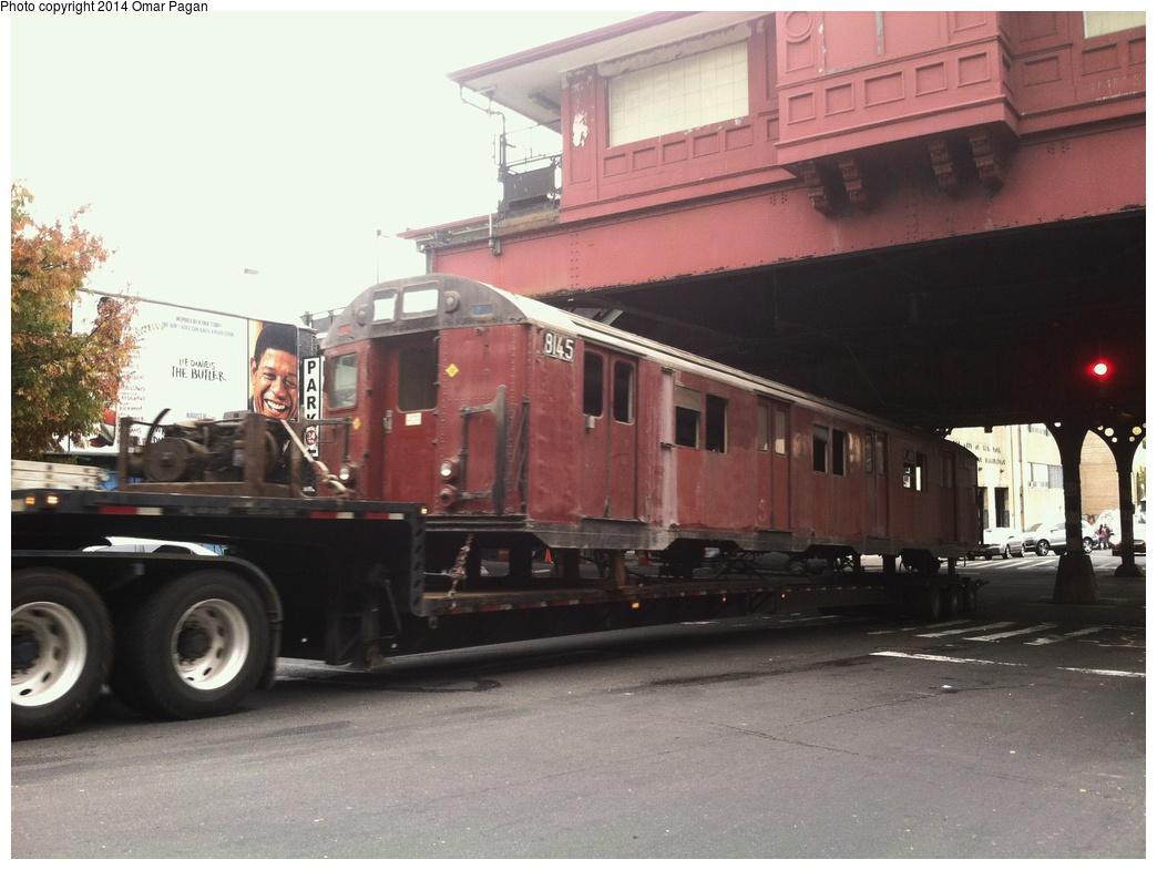 (263k, 1044x785)<br><b>Country:</b> United States<br><b>City:</b> New York<br><b>System:</b> New York City Transit<br><b>Location:</b> 207th Street Yard<br><b>Car:</b> R-27 (St. Louis, 1960)  8145 <br><b>Photo by:</b> Omar Pagan<br><b>Date:</b> 10/22/2013<br><b>Notes:</b> Departing 207th St yard at 215th Street and 10th Avenue. Being sent to scrap to SIMS Metal Management in Newark, New Jersey.<br><b>Viewed (this week/total):</b> 2 / 1103