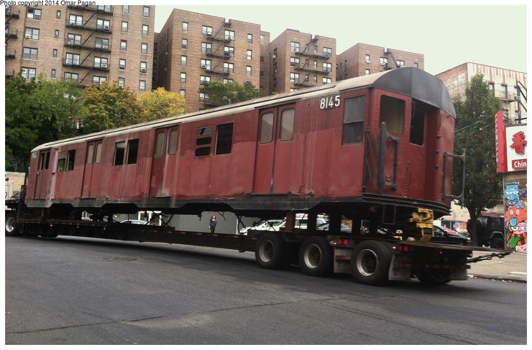 (297k, 1044x687)<br><b>Country:</b> United States<br><b>City:</b> New York<br><b>System:</b> New York City Transit<br><b>Location:</b> 207th Street Yard<br><b>Car:</b> R-27 (St. Louis, 1960)  8145 <br><b>Photo by:</b> Omar Pagan<br><b>Date:</b> 10/22/2013<br><b>Notes:</b> Departing 207th St yard at 215th Street and 10th Avenue. Being sent to scrap to SIMS Metal Management in Newark, New Jersey.<br><b>Viewed (this week/total):</b> 0 / 1093