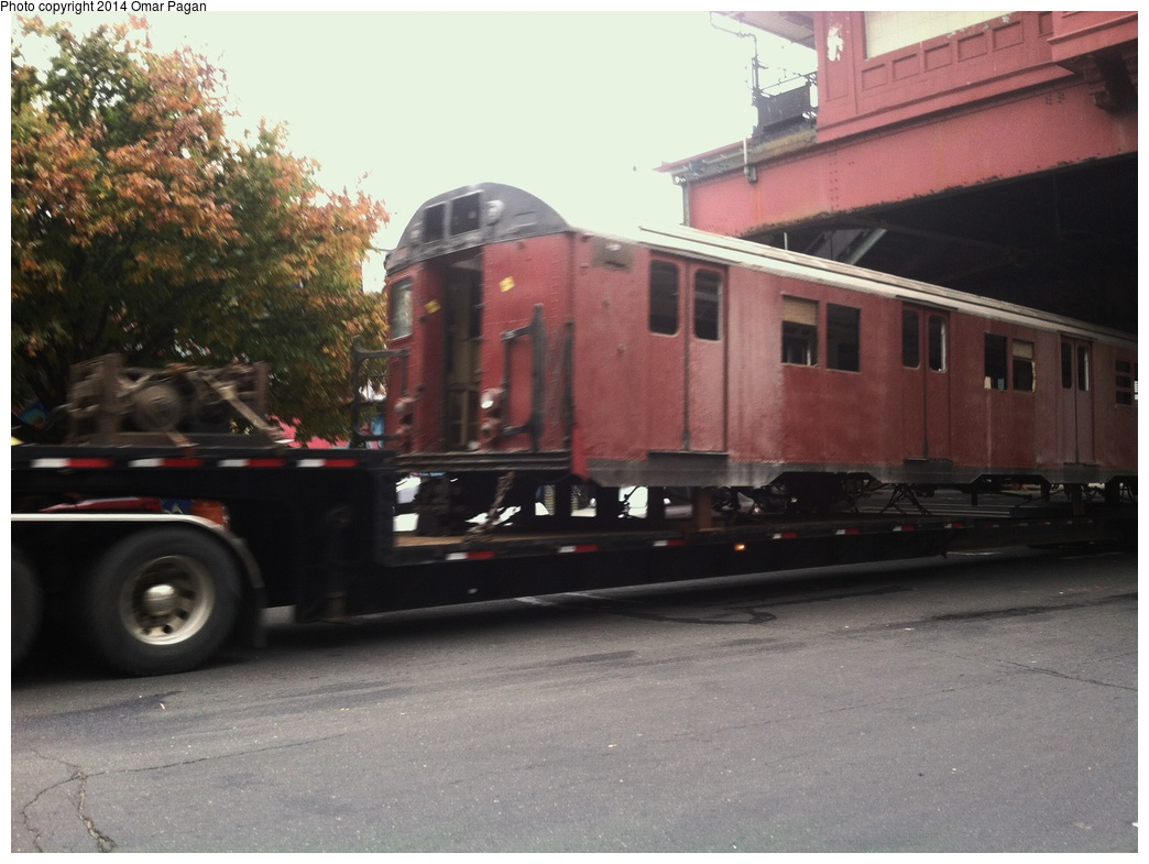 (269k, 1044x785)<br><b>Country:</b> United States<br><b>City:</b> New York<br><b>System:</b> New York City Transit<br><b>Location:</b> 207th Street Yard<br><b>Car:</b> R-30 (St. Louis, 1961) 8463 <br><b>Photo by:</b> Omar Pagan<br><b>Date:</b> 10/22/2013<br><b>Notes:</b> Departing 207th St yard at 215th Street and 10th Avenue. Being sent to scrap to SIMS Metal Management in Newark, New Jersey.<br><b>Viewed (this week/total):</b> 2 / 693