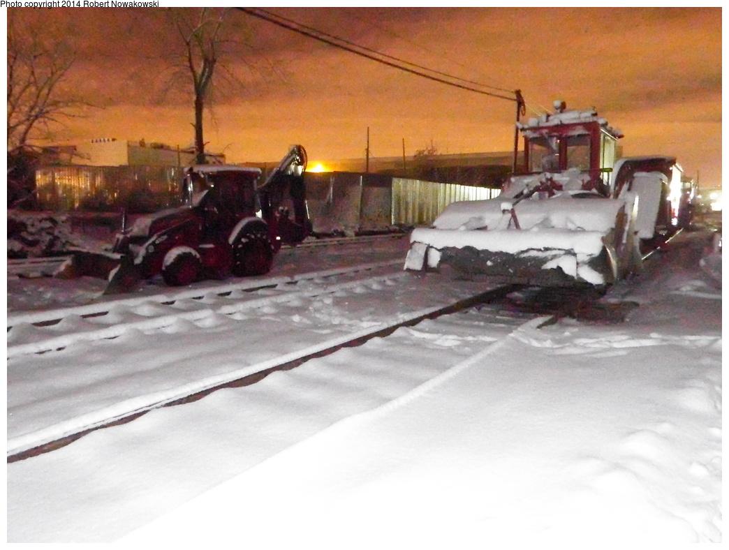 (288k, 1044x788)<br><b>Country:</b> United States<br><b>City:</b> New York<br><b>System:</b> Long Island Rail Road<br><b>Line:</b> LIRR Long Island City<br><b>Location:</b> Greenpoint Avenue <br><b>Photo by:</b> Robert Nowakowski<br><b>Date:</b> 2/3/2014<br><b>Notes:</b> Track ballasting equipment.<br><b>Viewed (this week/total):</b> 1 / 1280