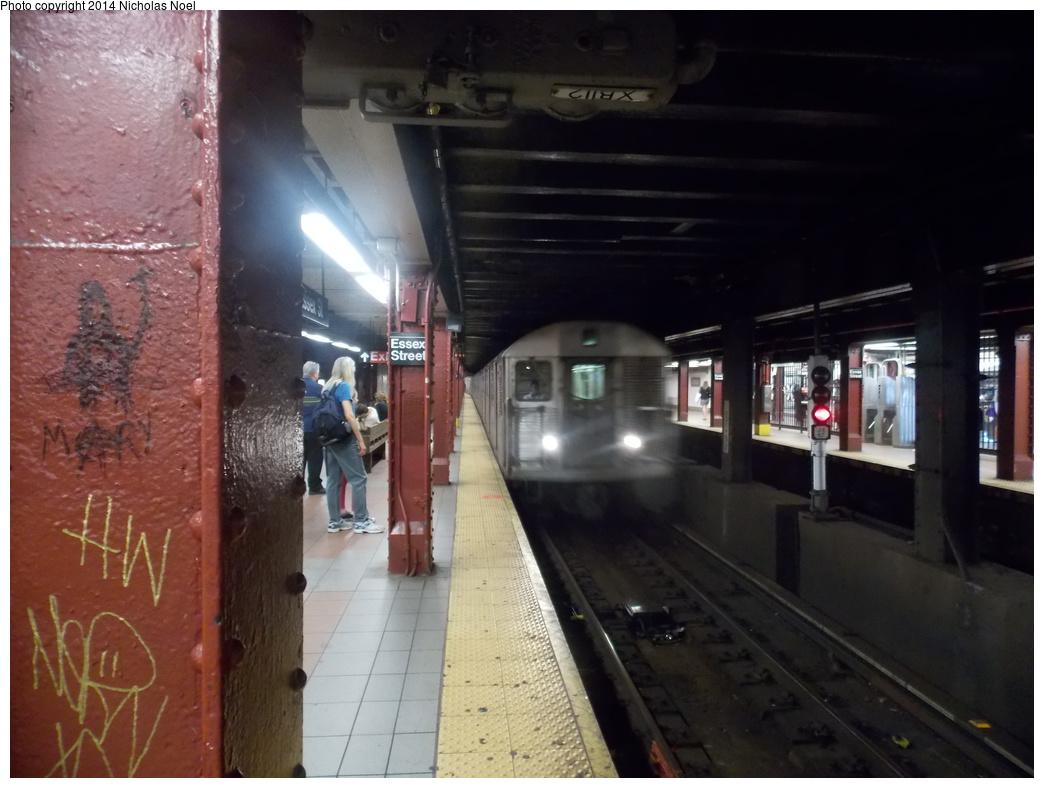 (305k, 1044x788)<br><b>Country:</b> United States<br><b>City:</b> New York<br><b>System:</b> New York City Transit<br><b>Line:</b> BMT Nassau Street/Jamaica Line<br><b>Location:</b> Essex Street <br><b>Route:</b> J<br><b>Car:</b> R-32 (Budd, 1964)   <br><b>Photo by:</b> Nicholas Noel<br><b>Date:</b> 6/7/2014<br><b>Viewed (this week/total):</b> 1 / 1139