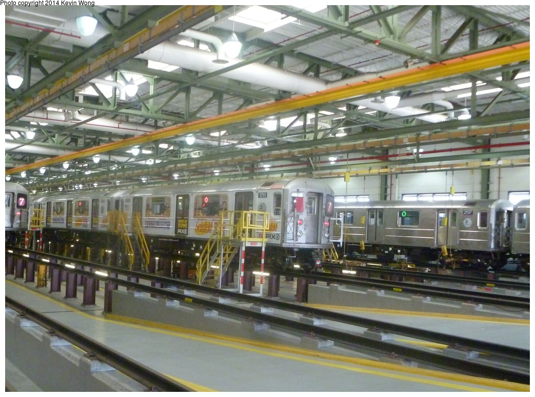 (351k, 1044x775)<br><b>Country:</b> United States<br><b>City:</b> New York<br><b>System:</b> New York City Transit<br><b>Location:</b> Corona Shops<br><b>Car:</b> R-62A (Bombardier, 1984-1987)  1711 <br><b>Photo by:</b> Kevin Wong<br><b>Date:</b> 6/7/2014<br><b>Notes:</b> Seinfeld ad-wrap train.<br><b>Viewed (this week/total):</b> 0 / 661