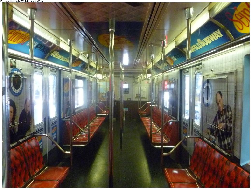(376k, 1044x788)<br><b>Country:</b> United States<br><b>City:</b> New York<br><b>System:</b> New York City Transit<br><b>Location:</b> Corona Shops<br><b>Car:</b> R-62A (Bombardier, 1984-1987)  1711 <br><b>Photo by:</b> Kevin Wong<br><b>Date:</b> 6/7/2014<br><b>Notes:</b> Seinfeld ad-wrap train.<br><b>Viewed (this week/total):</b> 0 / 904