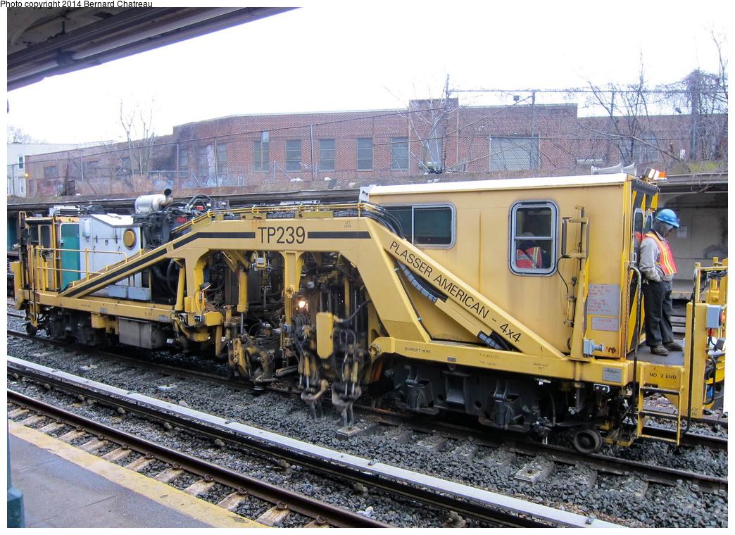 (396k, 1044x760)<br><b>Country:</b> United States<br><b>City:</b> New York<br><b>System:</b> New York City Transit<br><b>Line:</b> BMT Sea Beach Line<br><b>Location:</b> New Utrecht Avenue <br><b>Route:</b> Work Service<br><b>Car:</b> Ballast Tamper TP239 <br><b>Photo by:</b> Bernard Chatreau<br><b>Date:</b> 4/16/2011<br><b>Viewed (this week/total):</b> 0 / 917