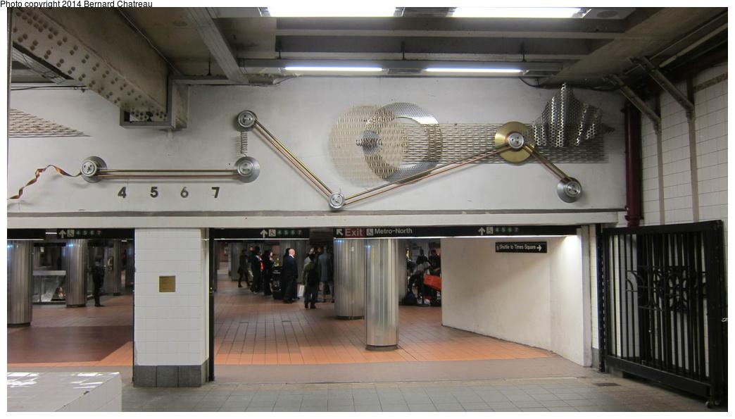 (211k, 1044x595)<br><b>Country:</b> United States<br><b>City:</b> New York<br><b>System:</b> New York City Transit<br><b>Line:</b> IRT Times Square-Grand Central Shuttle<br><b>Location:</b> Grand Central <br><b>Photo by:</b> Bernard Chatreau<br><b>Date:</b> 4/8/2011<br><b>Artwork:</b> <i>Fast Track & Speed Wheels</i>, Dan Sinclair (1990).<br><b>Viewed (this week/total):</b> 0 / 773