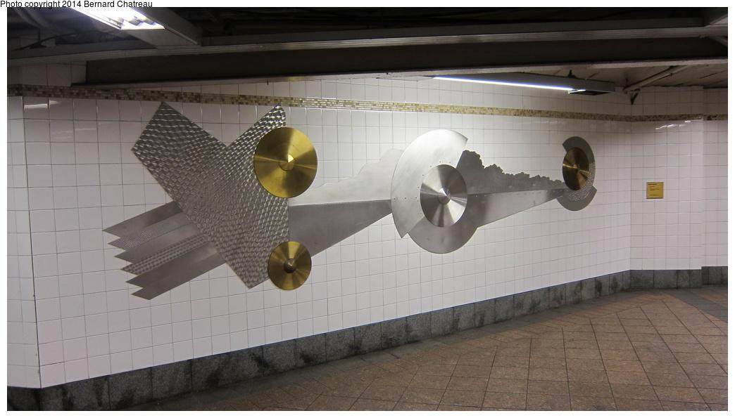 (202k, 1044x595)<br><b>Country:</b> United States<br><b>City:</b> New York<br><b>System:</b> New York City Transit<br><b>Line:</b> IRT Times Square-Grand Central Shuttle<br><b>Location:</b> Grand Central <br><b>Photo by:</b> Bernard Chatreau<br><b>Date:</b> 4/8/2011<br><b>Artwork:</b> <i>Fast Track & Speed Wheels</i>, Dan Sinclair (1990).<br><b>Viewed (this week/total):</b> 5 / 1001