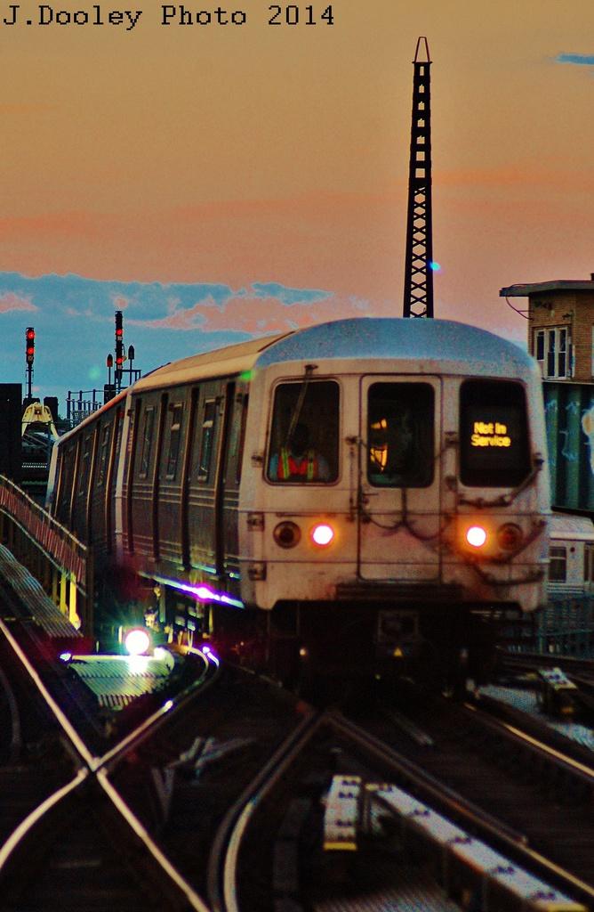 (300k, 668x1024)<br><b>Country:</b> United States<br><b>City:</b> New York<br><b>System:</b> New York City Transit<br><b>Line:</b> IND Fulton Street Line<br><b>Location:</b> Rockaway Boulevard <br><b>Route:</b> A layup<br><b>Car:</b> R-46 (Pullman-Standard, 1974-75) 5922 <br><b>Photo by:</b> John Dooley<br><b>Date:</b> 6/26/2014<br><b>Viewed (this week/total):</b> 1 / 1433