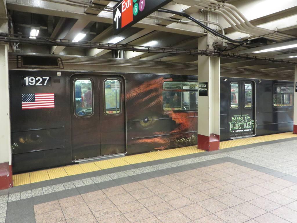 (126k, 1024x768)<br><b>Country:</b> United States<br><b>City:</b> New York<br><b>System:</b> New York City Transit<br><b>Line:</b> IRT Times Square-Grand Central Shuttle<br><b>Location:</b> Grand Central <br><b>Route:</b> S<br><b>Car:</b> R-62A (Bombardier, 1984-1987)  1927 <br><b>Photo by:</b> Robbie Rosenfeld<br><b>Date:</b> 8/14/2014<br><b>Notes:</b> TMNT ninja turtles movie wrap.<br><b>Viewed (this week/total):</b> 2 / 902