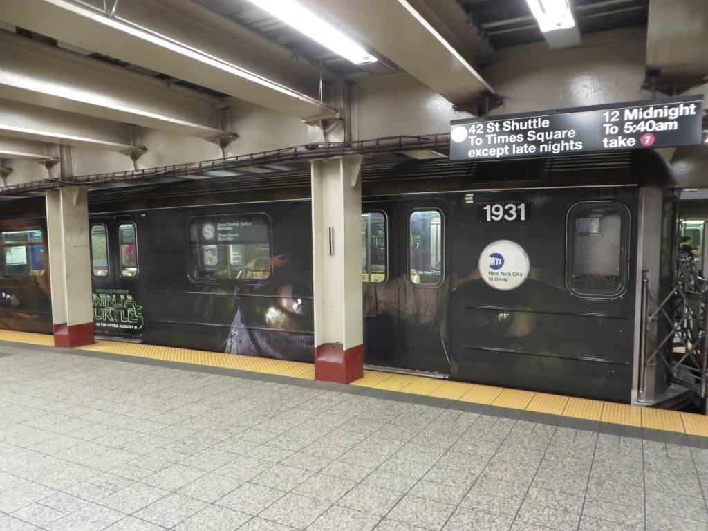 (124k, 1024x768)<br><b>Country:</b> United States<br><b>City:</b> New York<br><b>System:</b> New York City Transit<br><b>Line:</b> IRT Times Square-Grand Central Shuttle<br><b>Location:</b> Grand Central <br><b>Route:</b> S<br><b>Car:</b> R-62A (Bombardier, 1984-1987)  1931 <br><b>Photo by:</b> Robbie Rosenfeld<br><b>Date:</b> 8/14/2014<br><b>Notes:</b> TMNT ninja turtles movie wrap.<br><b>Viewed (this week/total):</b> 0 / 934