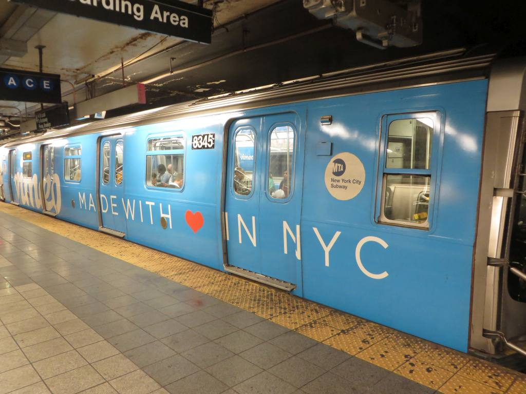 (113k, 1024x768)<br><b>Country:</b> United States<br><b>City:</b> New York<br><b>System:</b> New York City Transit<br><b>Line:</b> BMT Canarsie Line<br><b>Location:</b> 8th Avenue<br><b>Route:</b> L<br><b>Car:</b> R-160A-1 (Alstom, 2005-2008, 4 car sets) 8345 <br><b>Photo by:</b> Robbie Rosenfeld<br><b>Date:</b> 9/16/2014<br><b>Notes:</b> Vimeo ad wrap.<br><b>Viewed (this week/total):</b> 0 / 1491