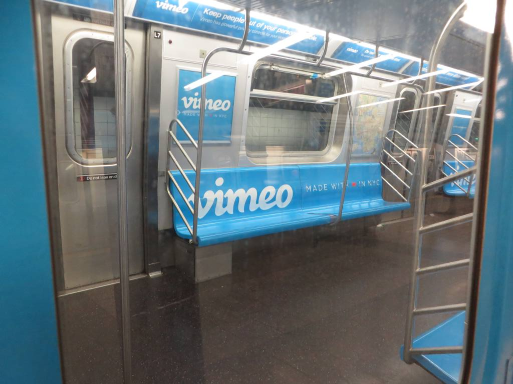 (108k, 1024x768)<br><b>Country:</b> United States<br><b>City:</b> New York<br><b>System:</b> New York City Transit<br><b>Line:</b> BMT Canarsie Line<br><b>Location:</b> 8th Avenue<br><b>Route:</b> L<br><b>Car:</b> R-160A-1 (Alstom, 2005-2008, 4 car sets) 8348 <br><b>Photo by:</b> Robbie Rosenfeld<br><b>Date:</b> 9/16/2014<br><b>Notes:</b> Vimeo ad wrap.<br><b>Viewed (this week/total):</b> 0 / 1190