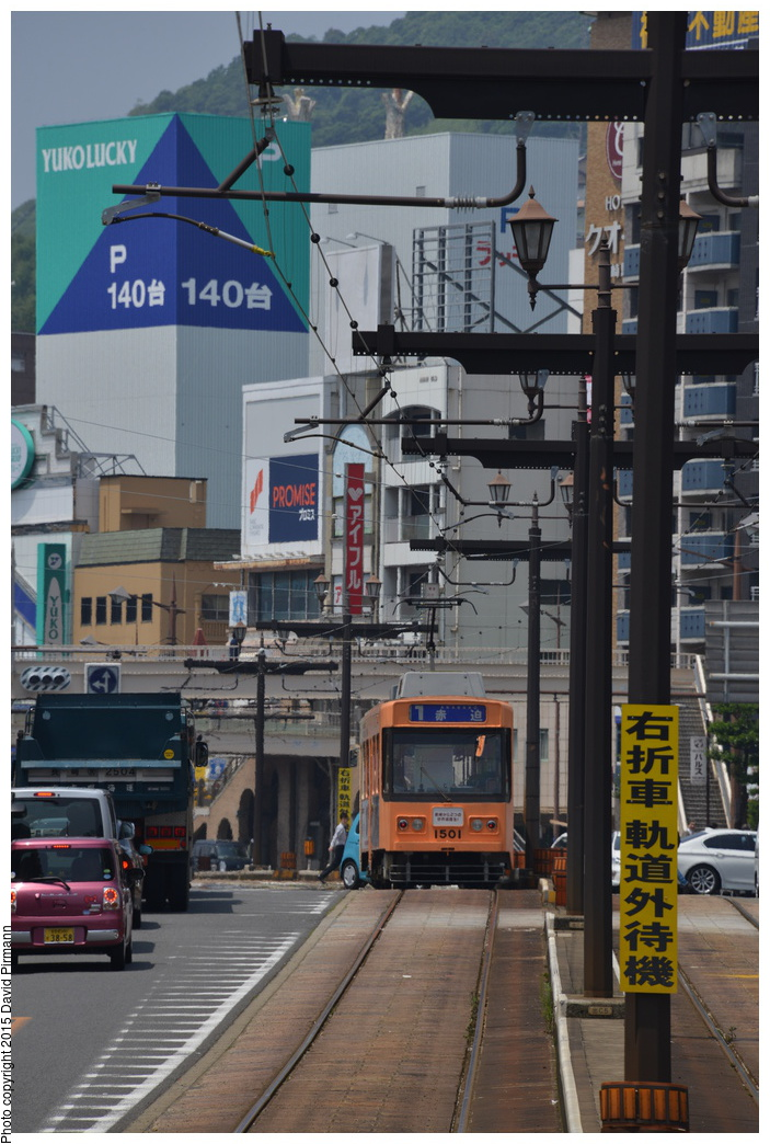(317k, 703x1044)<br><b>Country:</b> Japan<br><b>City:</b> Nagasaki<br><b>System:</b> Nagaden (Nagasaki Electric Railway)<br><b>Location:</b> 長崎駅前 Nagasaki Eki-mae (1,3) <br><b>Car:</b>  1501 <br><b>Photo by:</b> David Pirmann<br><b>Date:</b> 6/12/2015<br><b>Viewed (this week/total):</b> 0 / 551