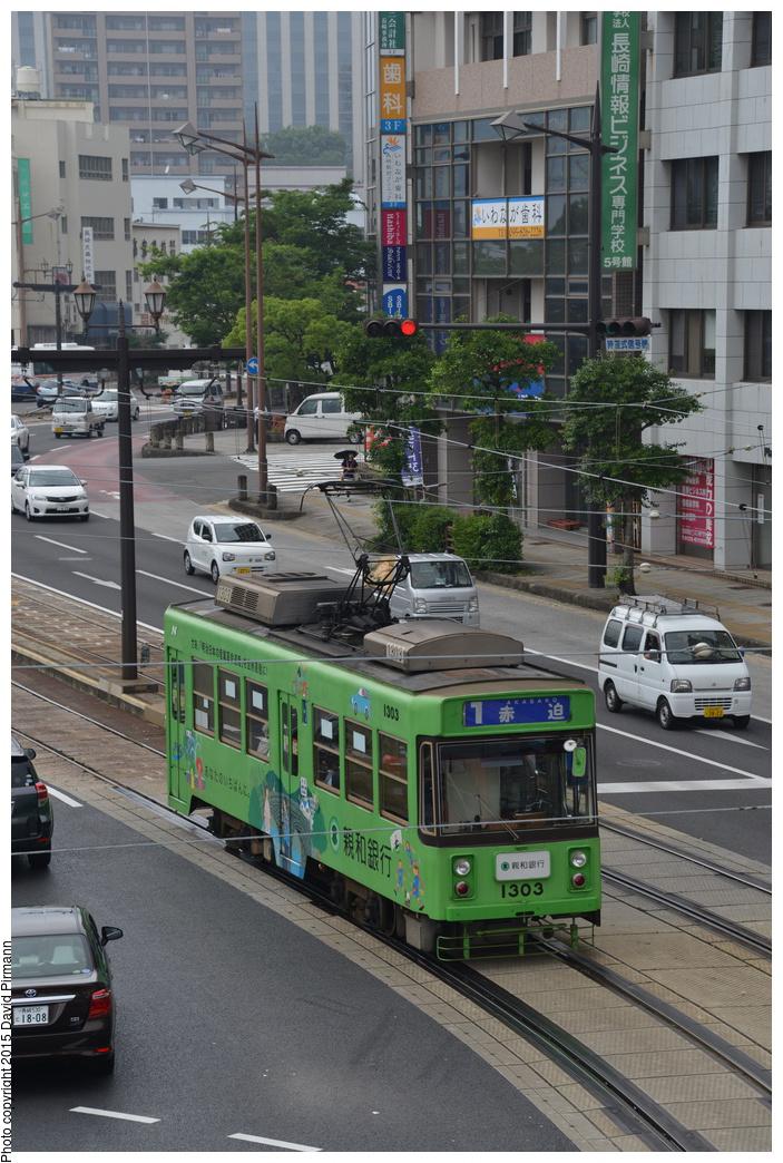 (370k, 703x1044)<br><b>Country:</b> Japan<br><b>City:</b> Nagasaki<br><b>System:</b> Nagaden (Nagasaki Electric Railway)<br><b>Location:</b> 長崎駅前 Nagasaki Eki-mae (1,3) <br><b>Car:</b>  1303 <br><b>Photo by:</b> David Pirmann<br><b>Date:</b> 6/12/2015<br><b>Viewed (this week/total):</b> 0 / 570