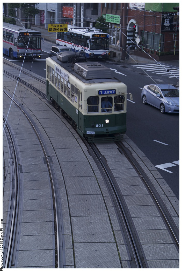 (311k, 703x1044)<br><b>Country:</b> Japan<br><b>City:</b> Nagasaki<br><b>System:</b> Nagaden (Nagasaki Electric Railway)<br><b>Location:</b> 長崎駅前 Nagasaki Eki-mae (1,3) <br><b>Car:</b>  201 <br><b>Photo by:</b> David Pirmann<br><b>Date:</b> 6/12/2015<br><b>Viewed (this week/total):</b> 0 / 487