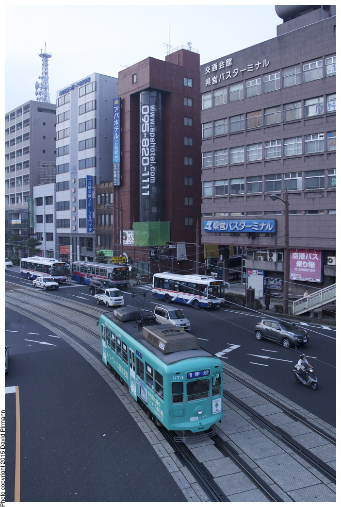 (292k, 703x1044)<br><b>Country:</b> Japan<br><b>City:</b> Nagasaki<br><b>System:</b> Nagaden (Nagasaki Electric Railway)<br><b>Location:</b> 長崎駅前 Nagasaki Eki-mae (1,3) <br><b>Car:</b>  374 <br><b>Photo by:</b> David Pirmann<br><b>Date:</b> 6/12/2015<br><b>Viewed (this week/total):</b> 1 / 590