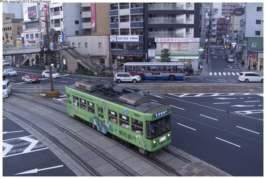(327k, 1044x703)<br><b>Country:</b> Japan<br><b>City:</b> Nagasaki<br><b>System:</b> Nagaden (Nagasaki Electric Railway)<br><b>Location:</b> 長崎駅前 Nagasaki Eki-mae (1,3) <br><b>Car:</b>  1303 <br><b>Photo by:</b> David Pirmann<br><b>Date:</b> 6/12/2015<br><b>Viewed (this week/total):</b> 0 / 649
