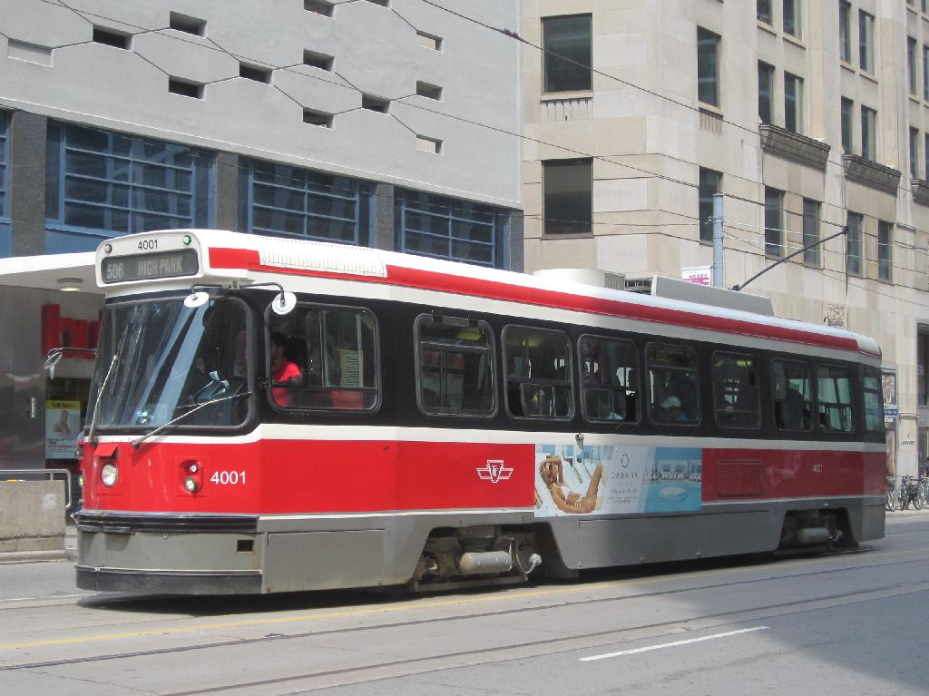 (119k, 1024x767)<br><b>Country:</b> Canada<br><b>City:</b> Toronto<br><b>System:</b> TTC<br><b>Line:</b> TTC 506-Carlton<br><b>Location:</b> Carlton/College/Yonge<br><b>Car:</b> TTC CLRV 4001 <br><b>Photo by:</b> Collection of nycsubway.org<br><b>Date:</b> 7/3/2015<br><b>Notes:</b> Westbound at Yonge.  Part of the sidewalk stairway into College subway station is visible in front of the car.<br><b>Viewed (this week/total):</b> 0 / 620