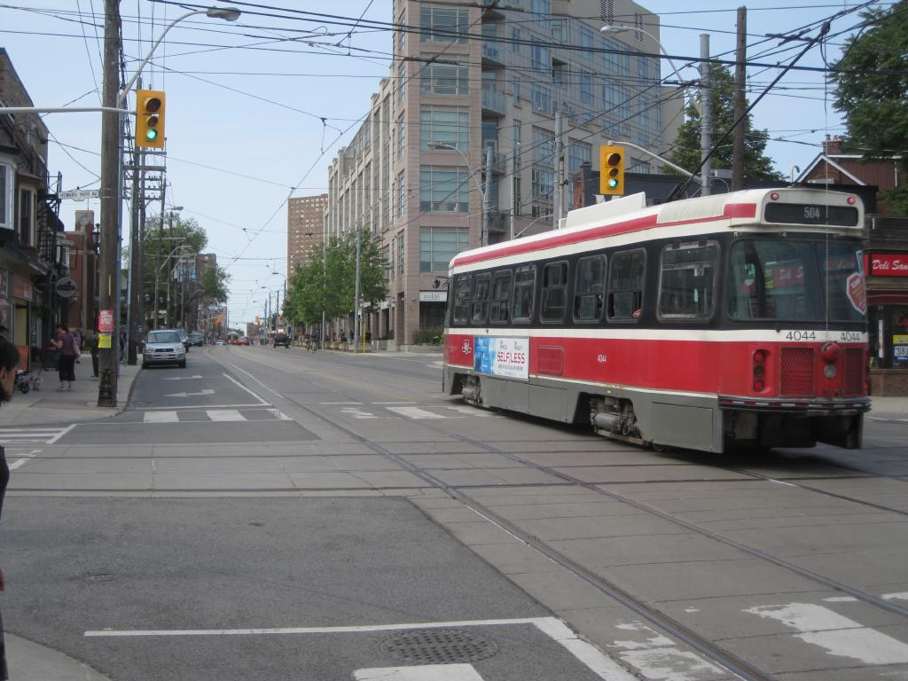 (126k, 1024x768)<br><b>Country:</b> Canada<br><b>City:</b> Toronto<br><b>System:</b> TTC<br><b>Line:</b> TTC 504-King<br><b>Location:</b> Roncesvalles/Howard Park <br><b>Car:</b> TTC CLRV 4044 <br><b>Photo by:</b> Collection of nycsubway.org <br><b>Date:</b> 7/3/2015<br><b>Notes:</b> Westbound to Dundas West, crossing the 506's tracks on Howard Park.  In the background is an eastbound 504 or 505 at the corner of Roncesvalles and Dundas.<br><b>Viewed (this week/total):</b> 0 / 435