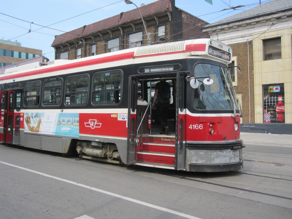 (122k, 1024x768)<br><b>Country:</b> Canada<br><b>City:</b> Toronto<br><b>System:</b> TTC<br><b>Line:</b> TTC 504-King<br><b>Location:</b> King/Queen W./Roncesvalles/The Queensway<br><b>Car:</b> TTC CLRV 4166 <br><b>Photo by:</b> Collection of nycsubway.org<br><b>Date:</b> 7/3/2015<br><b>Notes:</b> Eastbound (locally southbound) to Broadview.<br><b>Viewed (this week/total):</b> 0 / 510