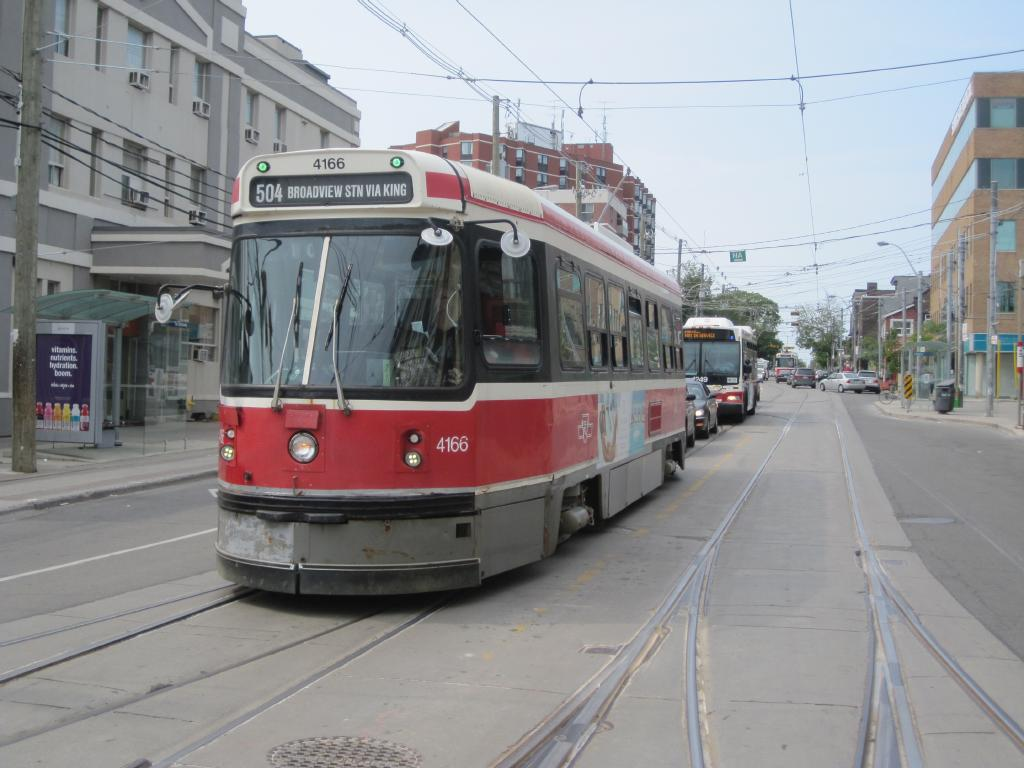 (104k, 1024x768)<br><b>Country:</b> Canada<br><b>City:</b> Toronto<br><b>System:</b> TTC<br><b>Line:</b> TTC 504-King<br><b>Location:</b> King/Queen W./Roncesvalles/The Queensway <br><b>Car:</b> TTC CLRV 4166 <br><b>Photo by:</b> Collection of nycsubway.org <br><b>Date:</b> 7/3/2015<br><b>Notes:</b> Eastbound (locally southbound), with a westbound car in the background.<br><b>Viewed (this week/total):</b> 1 / 416