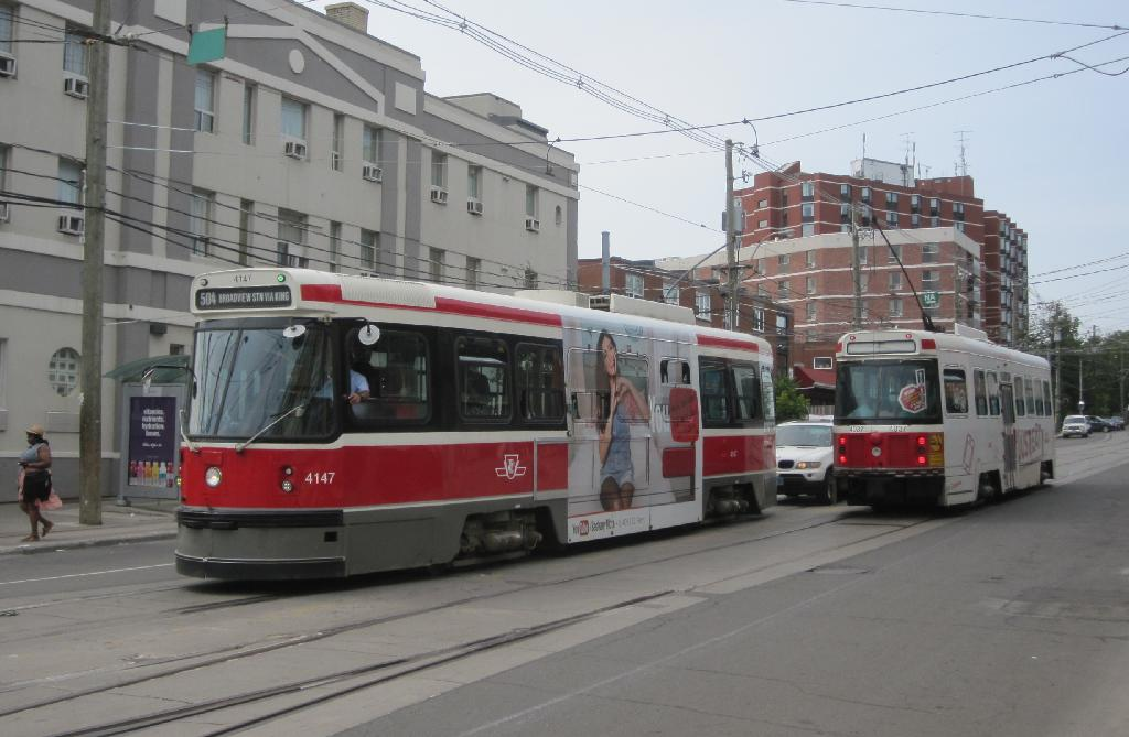 (97k, 1024x669)<br><b>Country:</b> Canada<br><b>City:</b> Toronto<br><b>System:</b> TTC<br><b>Line:</b> TTC 504-King<br><b>Location:</b> King/Queen W./Roncesvalles/The Queensway<br><b>Car:</b> TTC CLRV 4147 <br><b>Photo by:</b> Collection of nycsubway.org<br><b>Date:</b> 7/3/2015<br><b>Notes:</b> Eastbound (locally southbound) car 4147 passes westbound car 4037.<br><b>Viewed (this week/total):</b> 0 / 454