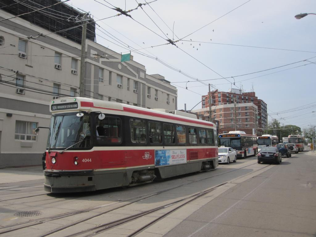 (101k, 1024x768)<br><b>Country:</b> Canada<br><b>City:</b> Toronto<br><b>System:</b> TTC<br><b>Line:</b> TTC 504-King<br><b>Location:</b> King/Queen W./Roncesvalles/The Queensway <br><b>Car:</b> TTC CLRV 4044 <br><b>Photo by:</b> Collection of nycsubway.org <br><b>Date:</b> 7/3/2015<br><b>Notes:</b> CLRV 4044, eastbound (locally southbound) on route 504, is followed by two buses on the same route.  The route is so busy that at peak times the TTC is supplementing the streetcars with buses, as far as Parliament St.  Car 4003 passes by westbound.<br><b>Viewed (this week/total):</b> 0 / 370