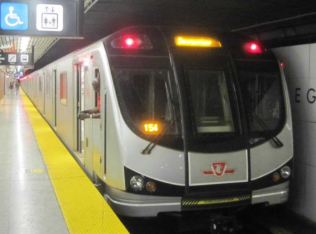 (92k, 1024x760)<br><b>Country:</b> Canada<br><b>City:</b> Toronto<br><b>System:</b> TTC<br><b>Line:</b> TTC Yonge-University-Spadina Subway<br><b>Location:</b> Eglinton<br><b>Photo by:</b> Collection of nycsubway.org<br><b>Date:</b> 7/3/2015<br><b>Notes:</b> Rear of northbound train at Eglinton station, with the guard now in the rear cab and the rear destination sign showing Downsview (which would be its destination if this was the front).<br><b>Viewed (this week/total):</b> 1 / 584