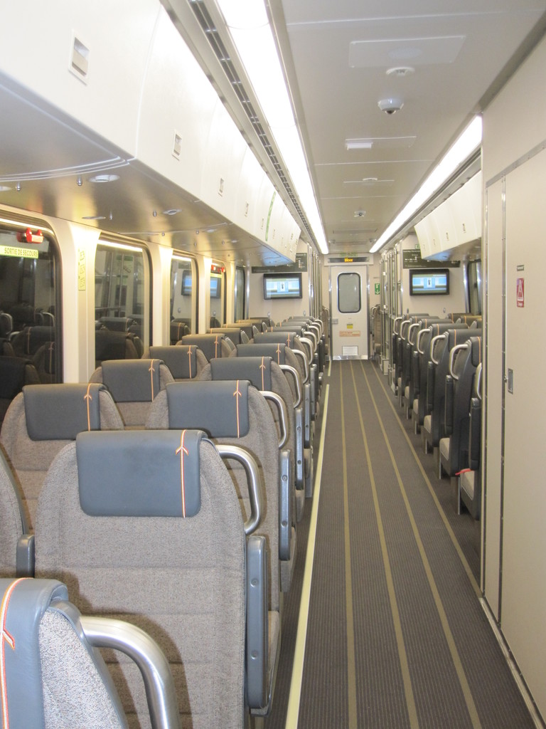(173k, 768x1024)<br><b>Country:</b> Canada<br><b>City:</b> Toronto<br><b>System:</b> Union-Pearson Express<br><b>Photo by:</b> Collection of nycsubway.org <br><b>Date:</b> 6/8/2015<br><b>Notes:</b> Train interior, showing the seating and overhead bins.<br><b>Viewed (this week/total):</b> 0 / 1138