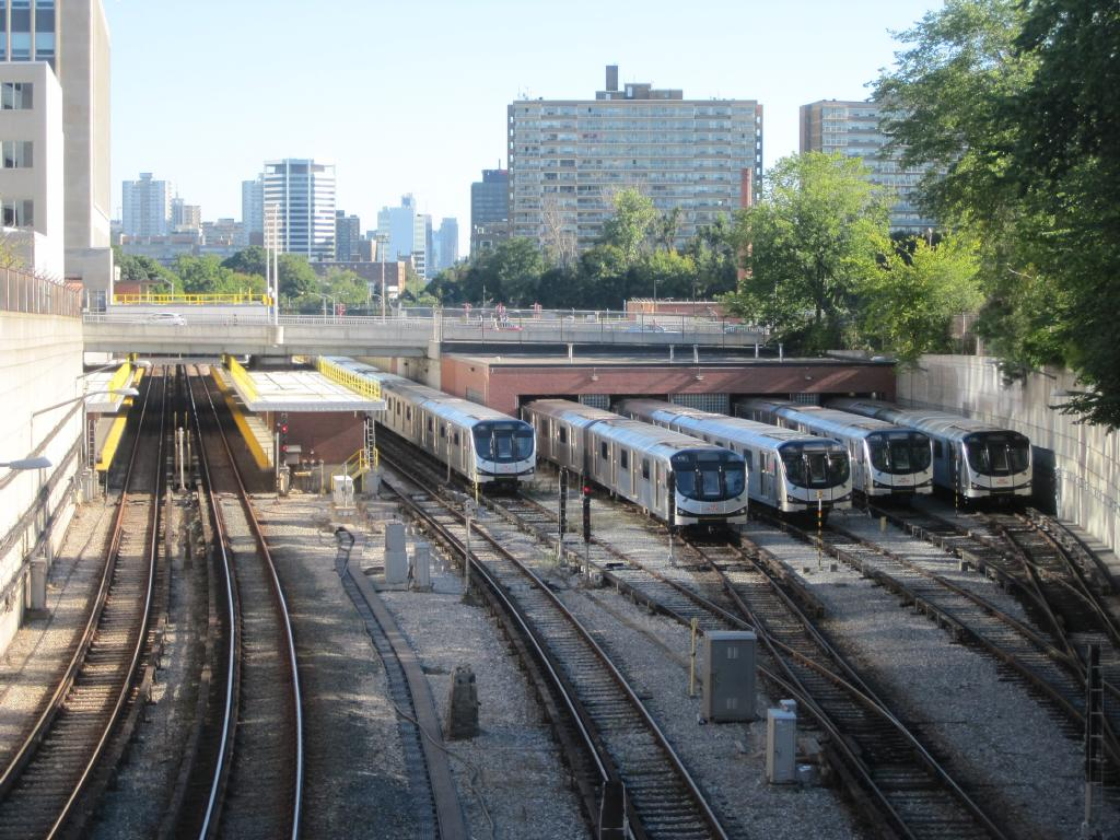 (155k, 1024x768)<br><b>Country:</b> Canada<br><b>City:</b> Toronto<br><b>System:</b> TTC<br><b>Line:</b> TTC Yonge-University-Spadina Subway<br><b>Location:</b> Davisville Yard<br><b>Photo by:</b> Collection of nycsubway.org<br><b>Date:</b> 9/7/2014<br><b>Notes:</b> Davisville station and yard, with five TR trains parked, seen looking south from the Imperial St. bridge.<br><b>Viewed (this week/total):</b> 1 / 641