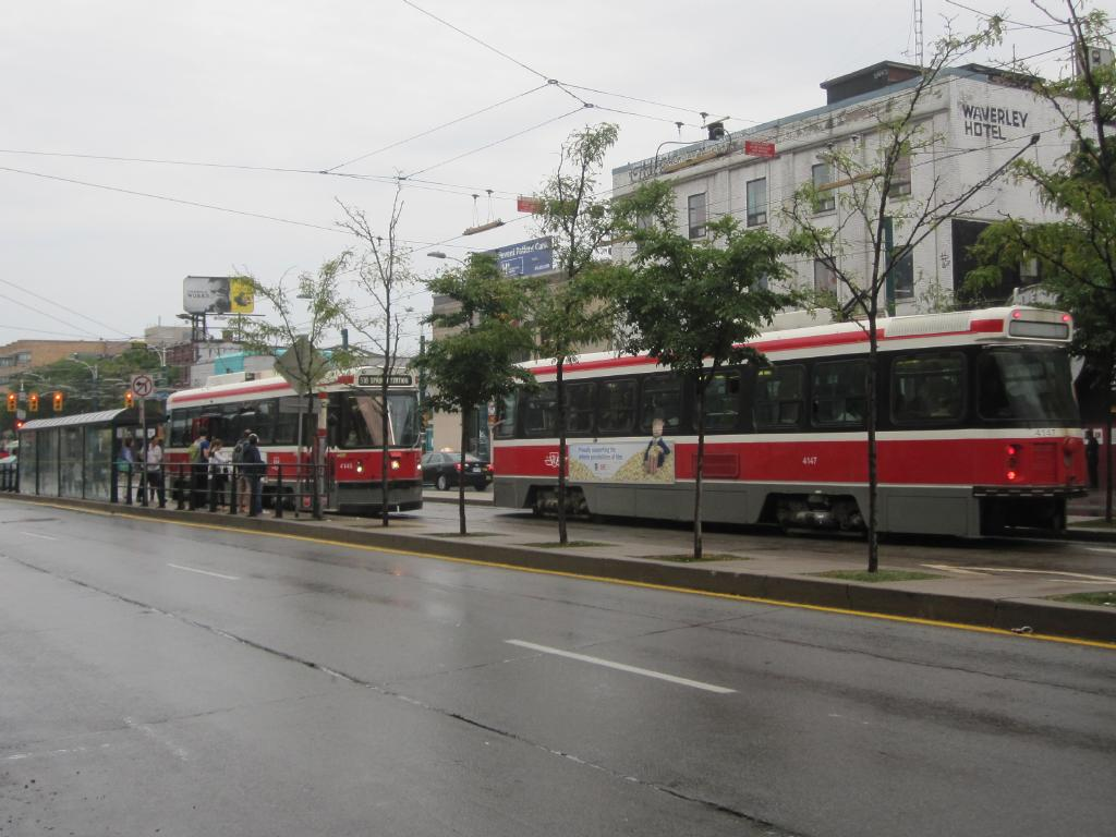 (108k, 1024x768)<br><b>Country:</b> Canada<br><b>City:</b> Toronto<br><b>System:</b> TTC<br><b>Line:</b> TTC 510-Spadina<br><b>Location:</b> Spadina/College <br><b>Car:</b> TTC CLRV 4145,4147 <br><b>Photo by:</b> Collection of nycsubway.org <br><b>Date:</b> 9/10/2014<br><b>Notes:</b> Northbound CLRV 4145 and southbound 4147 on a wet day.<br><b>Viewed (this week/total):</b> 1 / 597