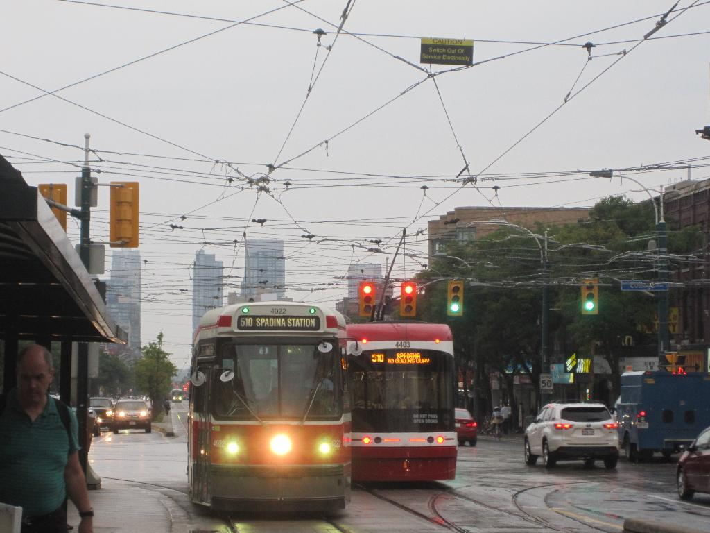 (108k, 1024x768)<br><b>Country:</b> Canada<br><b>City:</b> Toronto<br><b>System:</b> TTC<br><b>Line:</b> TTC 510-Spadina<br><b>Location:</b> Spadina/College<br><b>Car:</b> TTC CLRV 4022,4403 <br><b>Photo by:</b> Collection of nycsubway.org<br><b>Date:</b> 9/10/2014<br><b>Notes:</b> Northbound CLRV 4022 passes southbound Flexity car 4403 at College St. The overhead sign reads CAUTION - Switch Out of Service Electrically.<br><b>Viewed (this week/total):</b> 0 / 487