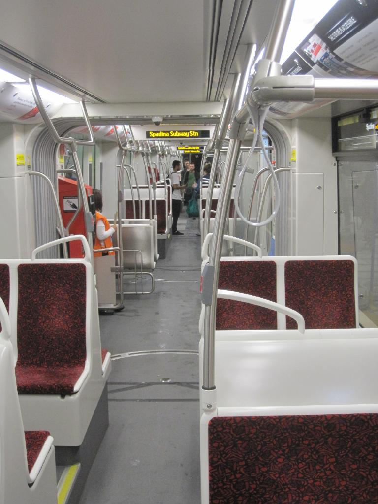 (97k, 768x1024)<br><b>Country:</b> Canada<br><b>City:</b> Toronto<br><b>System:</b> TTC<br><b>Line:</b> TTC 510-Spadina<br><b>Car:</b> TTC Flexity Outlook (Bombardier, 2009-) 4403 <br><b>Photo by:</b> Collection of nycsubway.org<br><b>Date:</b> 9/10/2014<br><b>Notes:</b> Interior view of Flexity car. Even though the cars are single-ended, half the seats face backwards.  Many seats are raised above the low floor to clear the wheels.<br><b>Viewed (this week/total):</b> 1 / 594