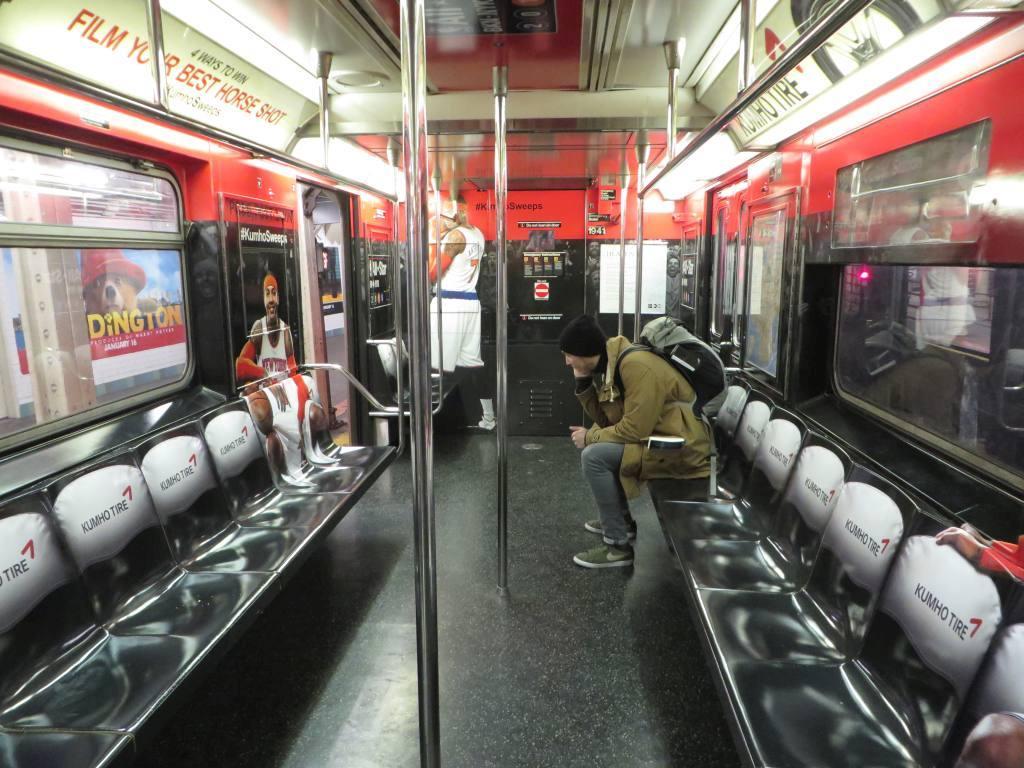 (140k, 1024x768)<br><b>Country:</b> United States<br><b>City:</b> New York<br><b>System:</b> New York City Transit<br><b>Route:</b> S<br><b>Car:</b> R-62A (Bombardier, 1984-1987)  1941 <br><b>Photo by:</b> Robbie Rosenfeld<br><b>Date:</b> 1/25/2015<br><b>Notes:</b> Kumho Tire/NBA All Star wrap<br><b>Viewed (this week/total):</b> 1 / 843