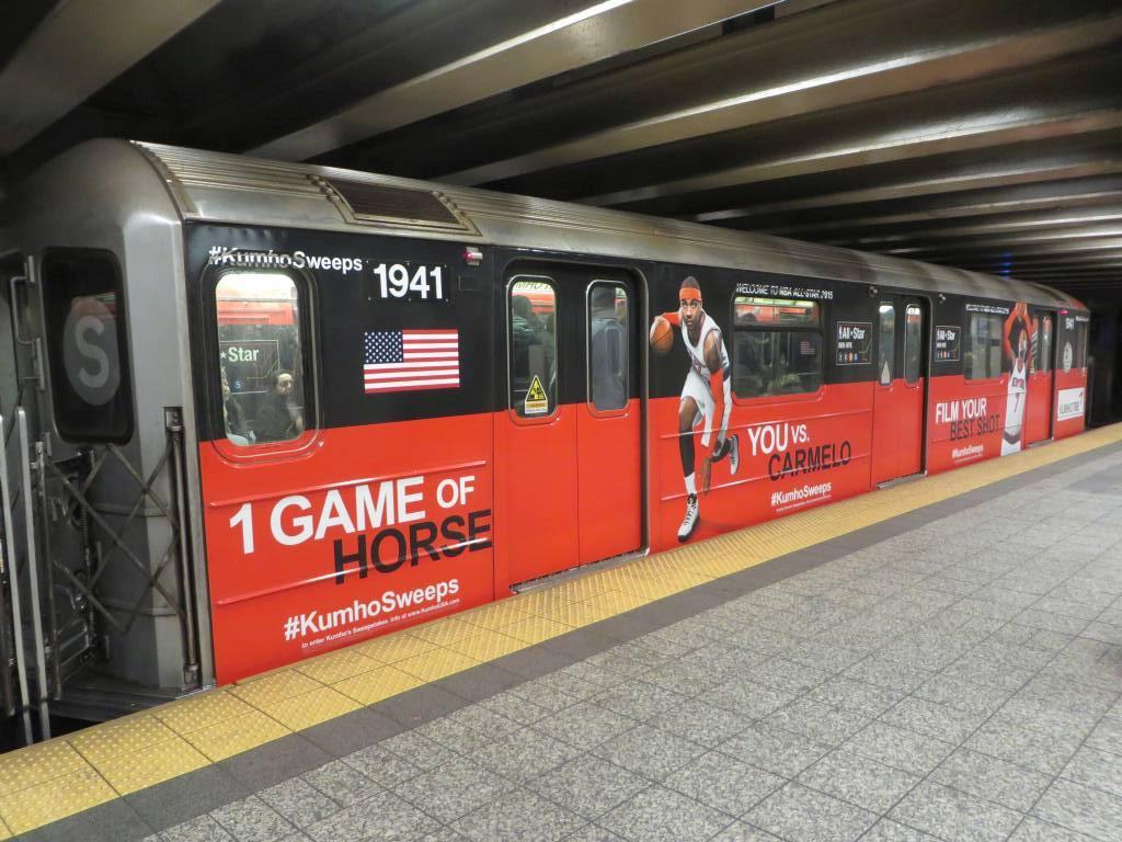 (180k, 1024x768)<br><b>Country:</b> United States<br><b>City:</b> New York<br><b>System:</b> New York City Transit<br><b>Line:</b> IRT Times Square-Grand Central Shuttle<br><b>Location:</b> Grand Central<br><b>Route:</b> S<br><b>Car:</b> R-62A (Bombardier, 1984-1987) 1941 <br><b>Photo by:</b> Robbie Rosenfeld<br><b>Date:</b> 1/26/2015<br><b>Notes:</b> Kumho Tire/NBA All Star wrap<br><b>Viewed (this week/total):</b> 0 / 950